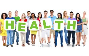 ethnic group of people holding sign that spells health