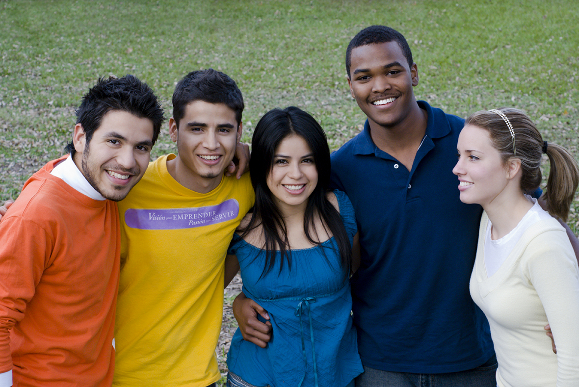 Group of Diverse Students Standing on lawn