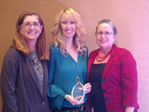 Dr Mary Kay Gilliland, Kim Bentley and Dr. Janice Pratt at Empowerment Systems award ceremony