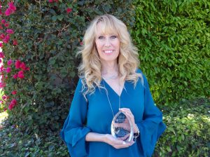 Kim Bentley Holds Health Innovation Award