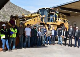 Students and dignitaries stand in front of loader donated to CAC by Vulcan