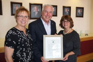 Casa Grande Mayor presents proclamation to Maggie Dooley and Jackie Guthrie