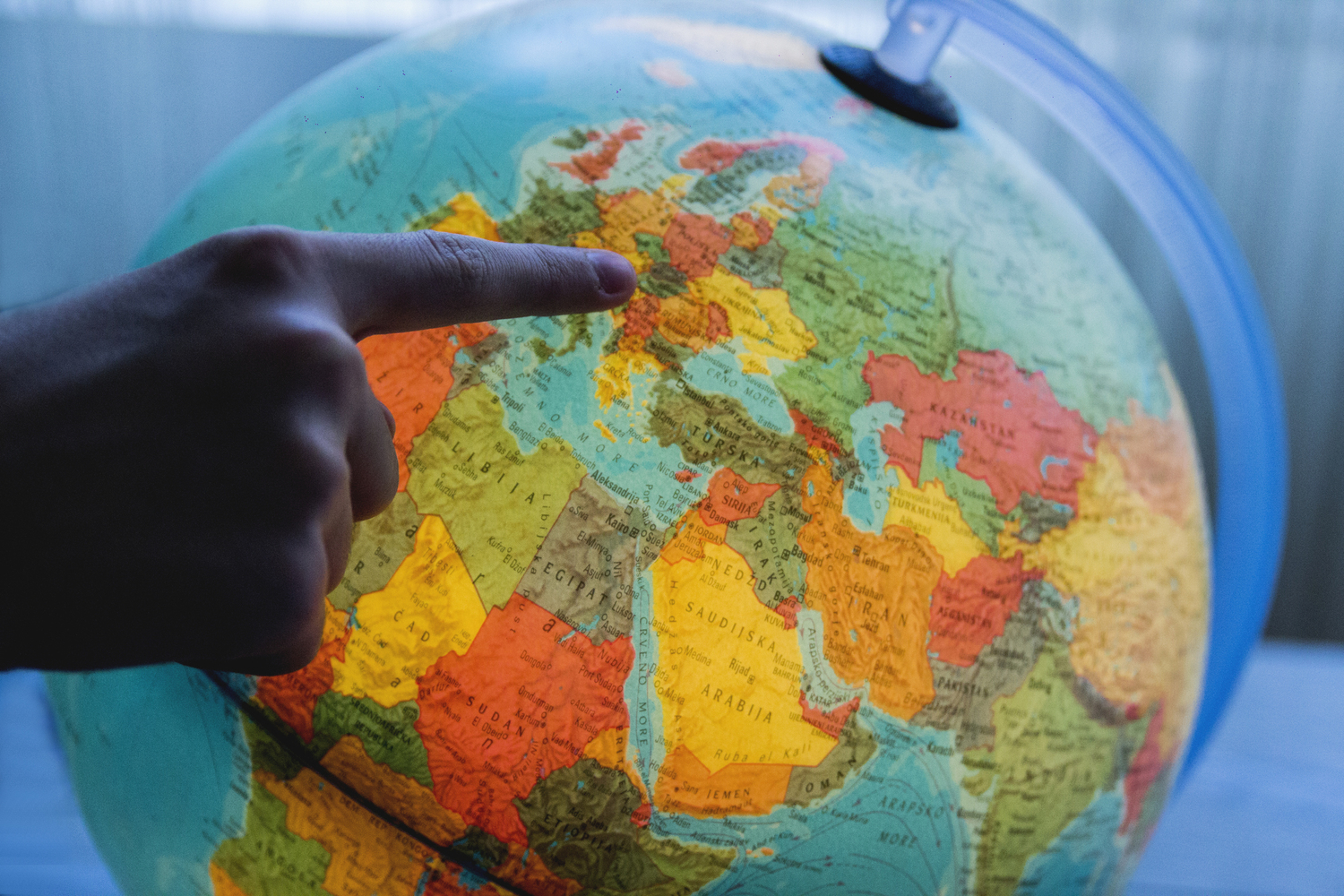 Finger pointing on globe
