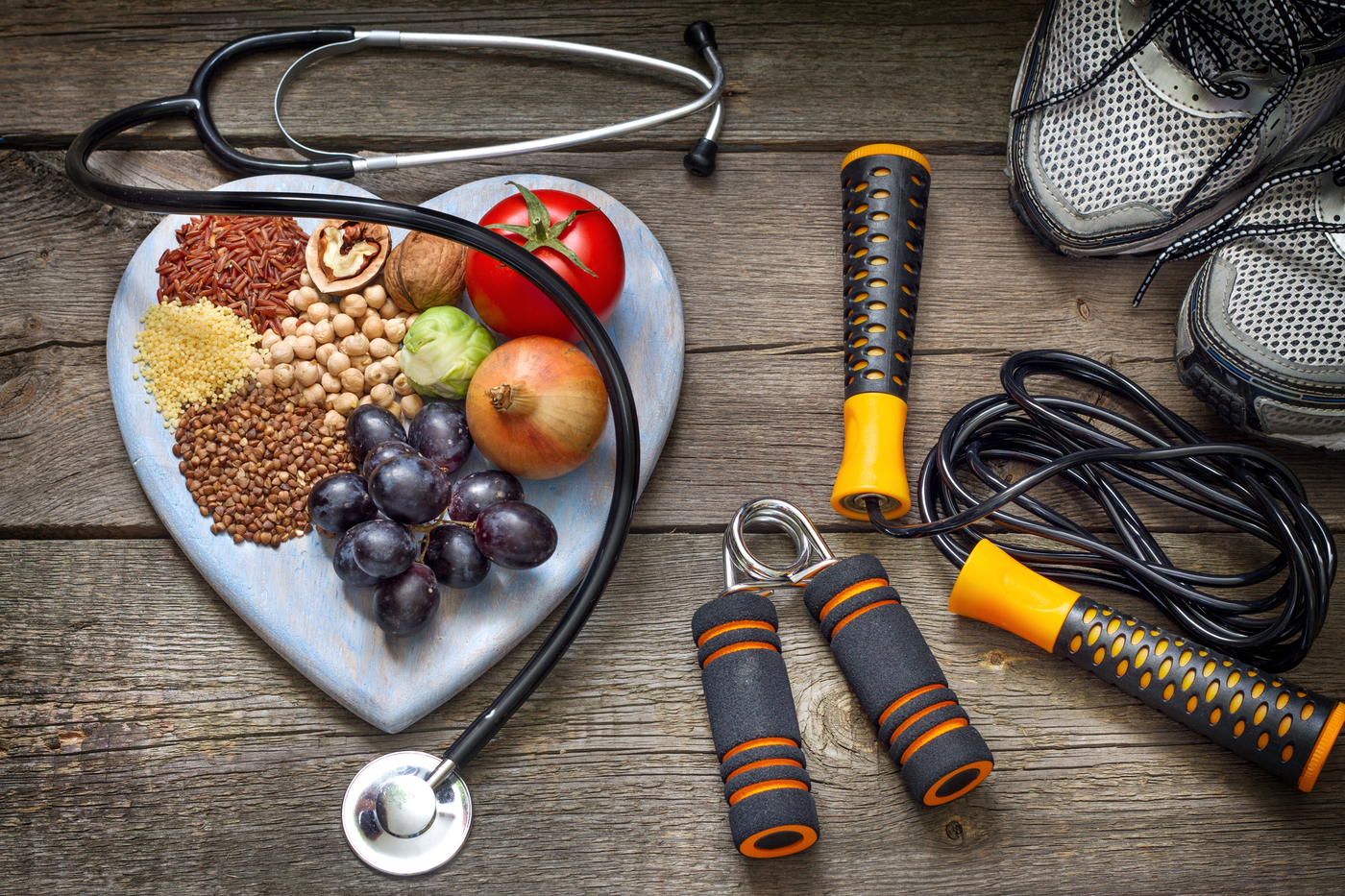 Healthy food, stethoscope, nutrition, weights, workout equipment