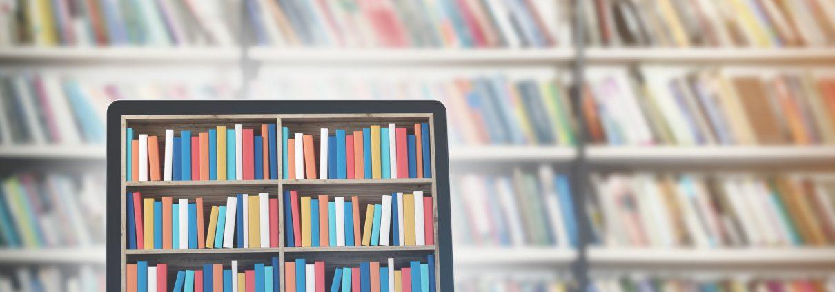 Bookshelf image on laptop in front of bookshelves
