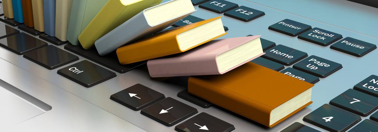 Small books on laptop keyboard
