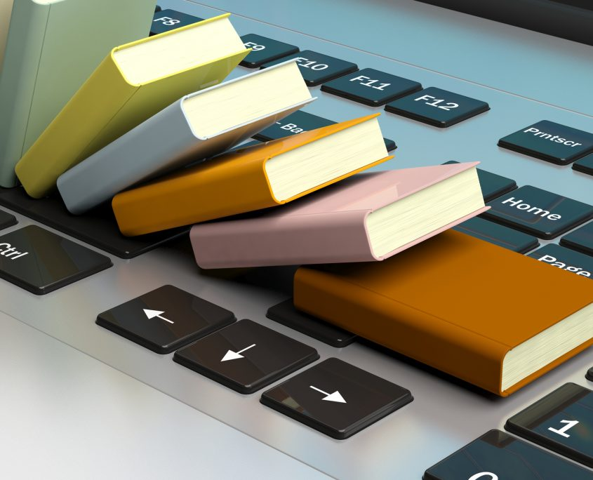 Small books on laptop keyboard