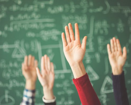 Students Raise hands in math class