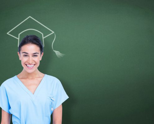 Nurse with graduation cap on