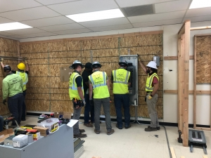 Commercial Electrician Installer Students wiring an electrical box